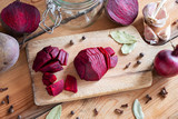 Sliced red beets with garlic and spices - ingredients to prepare beet kvass - 209578158