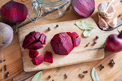 Foto Murales Sliced red beets with garlic and spices - ingredients to prepare beet kvass