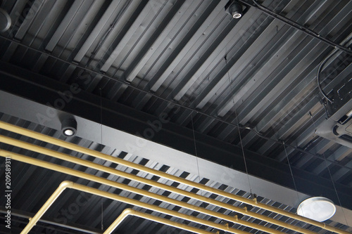 Foto Murales golden tubes, air conditioning and fixtures, on the ceiling