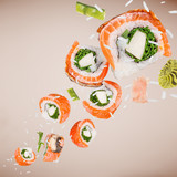 Pieces of delicious japanese sushi frozen in the air. - 209595577