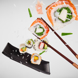 Pieces of delicious japanese sushi frozen in the air. - 209595598