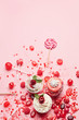 Sweets. Candy And Cupcakes On Pink Background