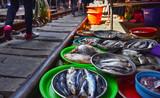 Selling food on the Maeklong Railway market in Thailand - 209600330