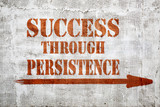 success through persistence  graffiti on stucco wall - 209601773