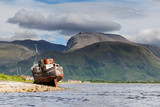 Ben Nevis.  The view across Loch Linnhe beyond an abandoned boat towards Ben Nevis, the highest mountain in Great Britain. - 209602797