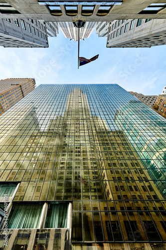 Foto Murales Building reflection in windows of another building in New York