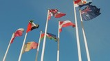 A lot of flags of different countries, flags flap in the wind. Slow motion - 209613745