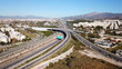 Aerial drone bird's eye view of popular highway of Attiki Odos multilevel junction road, passing through National motorway in traffic jam, Attica, Greece - 209613940