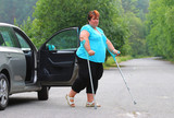 Disabled woman upgoing from a car. Transportation and travel for handicapped people. - 209616928