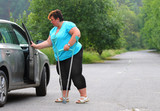 Disabled woman upgoing from a car. Transportation and travel for handicapped people. - 209616953