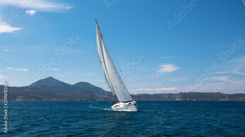 Sailing ship luxury yacht with white sails in the Mediterranean sea.