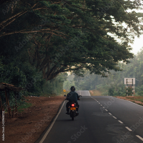 Man with the motorsycle stop on the road