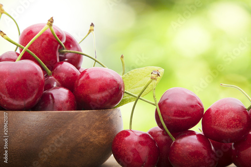 Foto Murales ripe cherries on a natural background
