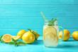 Leinwanddruck Bild - Natural lemonade in mason jar on wooden table