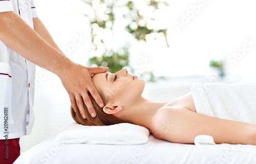 Leinwanddruck Bild beautiful girl enjoys massage and spa treatments