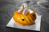 Tasty glazed cake on grey background - 209627561