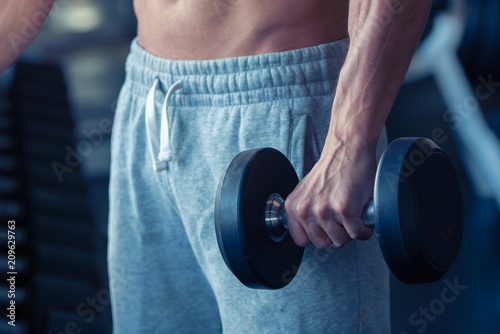 Aluminium Fitness Strong bodybuilder man lifting weights in the sport gym, close up ,bodybuilding and muscle building concept.