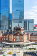 Asia Business concept for real estate and corporate construction - panoramic view of modern city skyline and tokyo station under clear sky in tokyo, japan