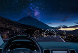car equipped with a HUD display driving at night along a mountain road .The concept of a modern car