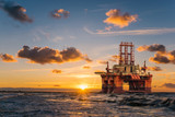 offshore oil rig at sunset - 209649504