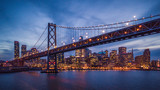 Cityscape view of San Francisco and the Bay Bridge at Night