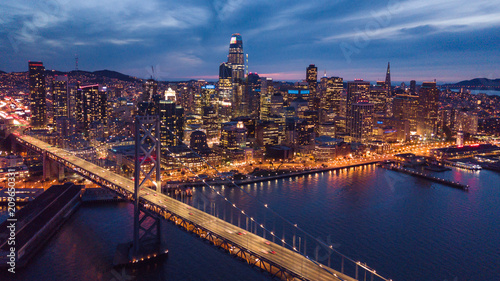 Aerial Cityscape view of San Francisco and the Bay Bridge at Night
