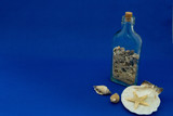 background image with a bottle of sands and shells (right side) - 209651941