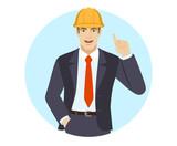 Businessman in construction helmet with hand in pocket pointing up - 209665771