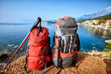 Hike with backpacks along the Mediterranean Sea in summer. - 209672910