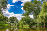 Wild river Drweca, polish landscapes, trees and green, dense brush growing by the river. Poland.Main transportation way of the Teutonic Knights in the Middle Ages.