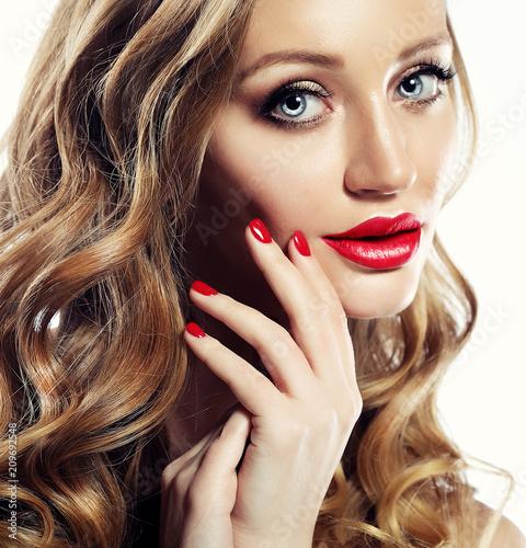 Leinwanddruck Bild Beautiful woman face closeup with long blond hair and vivid red lipstick