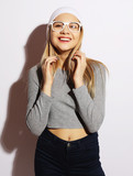 Cool hipster student woman wearing white eyewear glasses and hat. Caucasian female university student looking at camera smiling happy. - 209692954