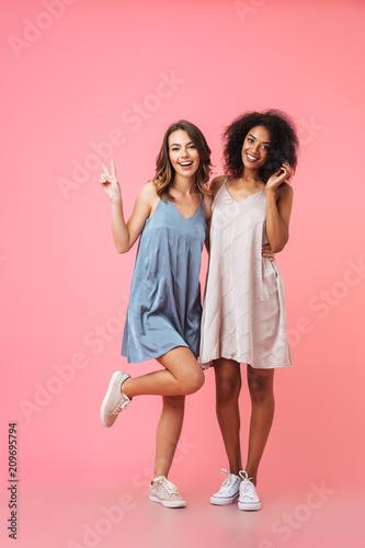 Full length portrait of two pretty smiling girls - 209695794