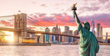 Statue Liberty and  New York city skyline at sunset - 209705506
