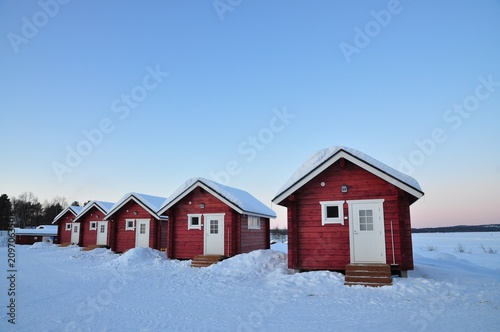 Foto Murales Cabins and snow in the North pole