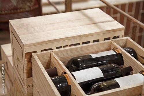 Fototapeta Wine bottles in wood box