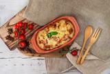 French Tartiflette Recipe Bacon, Potato and Reblochon Cheese Gratin - 209718102
