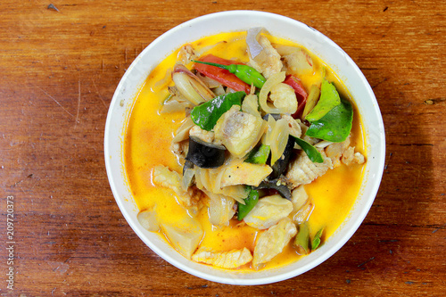 Foto Murales Spicy Tom Yum Soup in white blow with herb, a spicy clear soup typical in Thailand and No.1 Thai Dish Cuisine, hot and sour soup. Popular Thai Cuisine, Traditional food cuisine in Thailand,