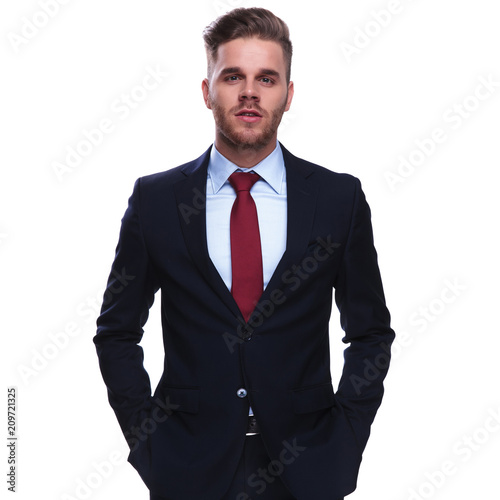 Foto Murales portrait of elegant attractive businessman with hands in pockets