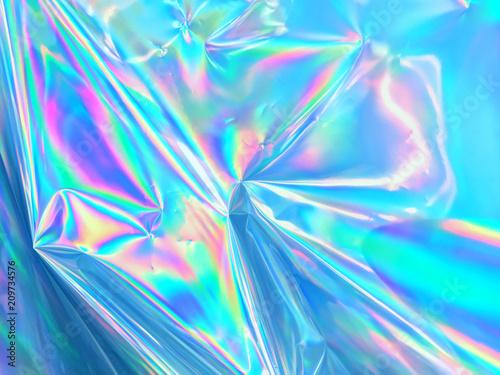 Holograficzna faktura opalizującej, pomarszczonej powierzchni niebieskiej folii.