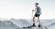 Leinwanddruck Bild - Fit young woman hiking in high altitude mountains