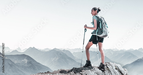 Leinwanddruck Bild Fit young woman hiking in high altitude mountains