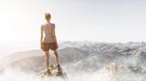 Frau steht auf einem Berggipfel am Morgen - 209746578