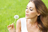 beautiful young woman with dandelion - 209754553