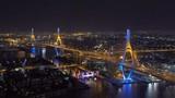 Bhumibol Bridge, Chao Phraya River, and buildings at night in transportation concept, Bangkok city, Thailand - 209760571