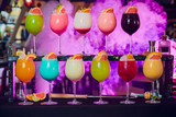 Various cocktails on dark background in cafe