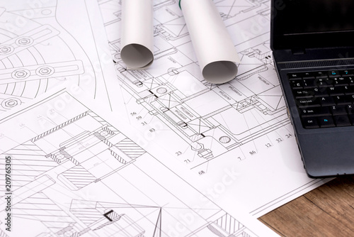 Engineering drawings of parts with a laptop