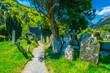 Leinwanddruck Bild - An Ancient cemetery in Glendalough settlement, Ireland