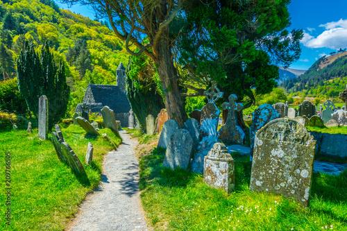 Leinwanddruck Bild An Ancient cemetery in Glendalough settlement, Ireland