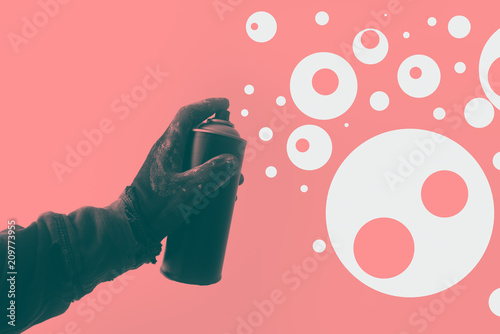 Duotone image of graffiti artist holding color spray can - 209773955